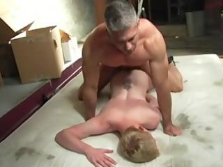 dad bareback on mat in garage