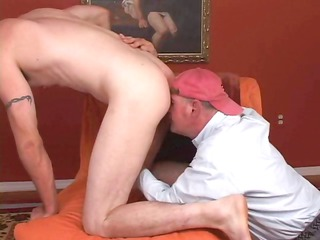 homosexual dude in a ball cap is engulfing pecker