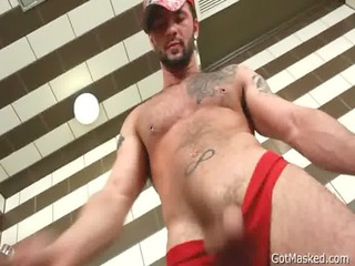 pierced hunk stuffing his arse with fake penis
