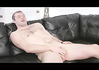 unshaved chested chap beating his meat