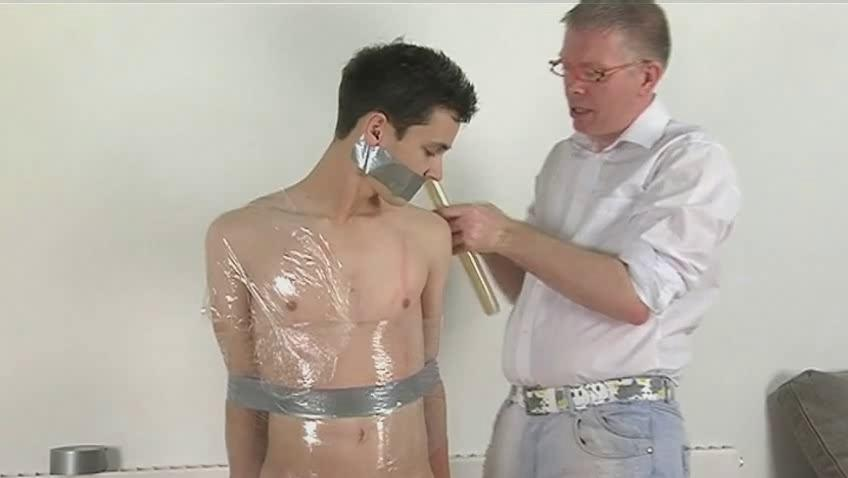 slim black haired homo receives bound and wrapped